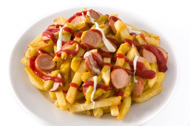 Typical latin america salchipapa. sausages with fries, ketchup, mustard and mayo