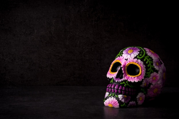 Typical mexican skull painted on black. copy space