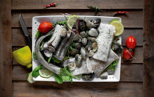 Typical neapolitan raw fish dish of the christmas period with capitone, eel, cod and clams