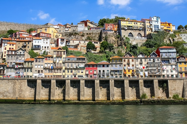 Typical porto houses next to the douro river, picturesque architecture of lined houses and bright colors. portugal. europe.