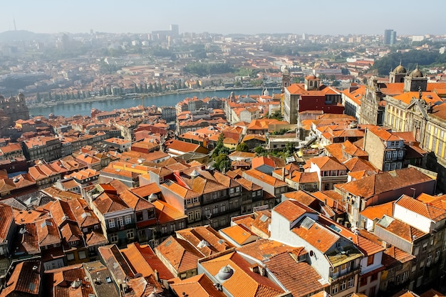 Typical porto houses next to the douro river, picturesque architecture of lined houses and bright colors. portugal.