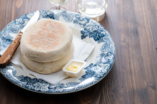 Typical portuguese bread of madeira bolo do caco with butter