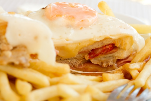 Typical portuguese dish francesinha on white plate