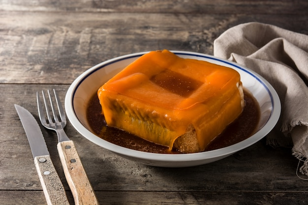 Typical portuguese francesinha sandwich on wooden table