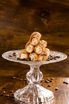 Typical sicilian pastries called cannoli with amarena listed in pastry on the plate