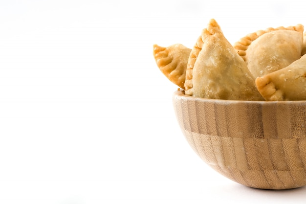 Typical spanish empanadas in bowl isolated copy space
