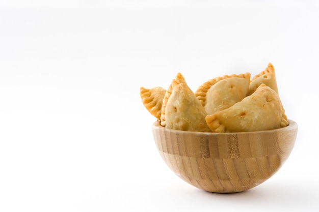 Typical spanish empanadas in bowl isolated