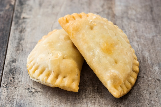 Typical spanish empanadas on wooden table