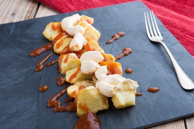 Typical spanish (tapa of patatas bravas)