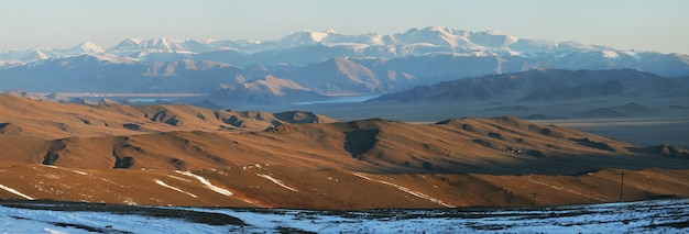 Typical views of mongoia with snowy peaks and desert mountains, panoramic view