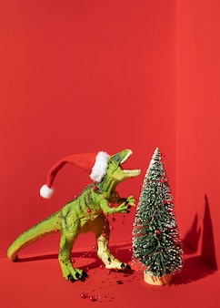 Tyrannosaurus rex toy with christmas tree