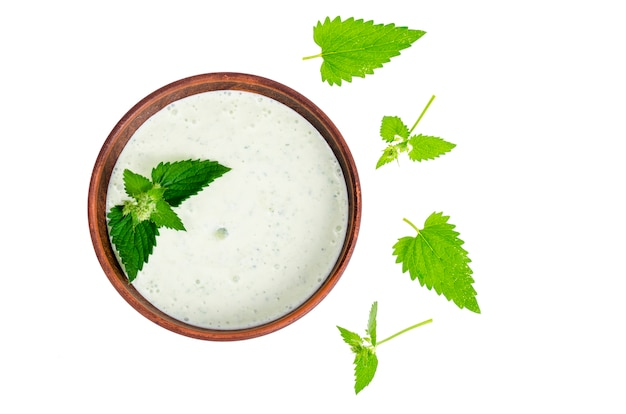 Tzatziki from cucumber and greek yogurt in ceramic bowl, isolated on white. mint leaves.