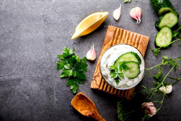 Tzatziki traditional greek sauce with ingredients cucumber