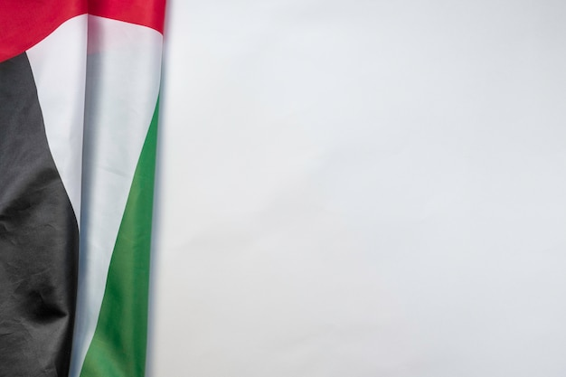 Uae flag on a white background with space for text on the right