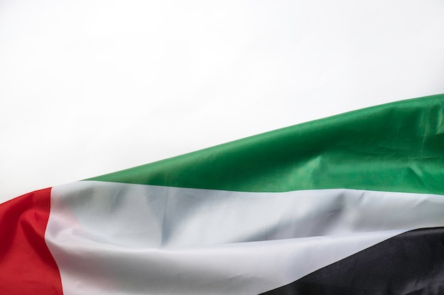 Uae flag on a white background with space for text on top