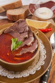 Ucrainian russian traditional vegetarian red soup - borsch. restaurant menu. fresh vegetables.
