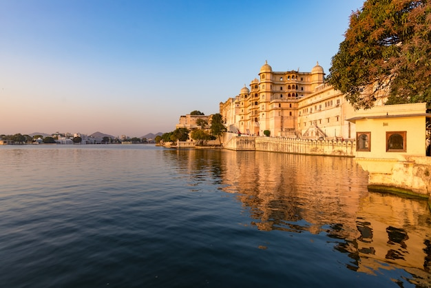 Udaipur cityscape at sunset. the majestic city palace on lake pichola, travel destination in rajasthan, india