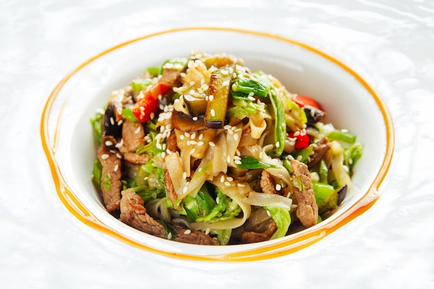 Udon noodles with beef meat and vegetables sesame