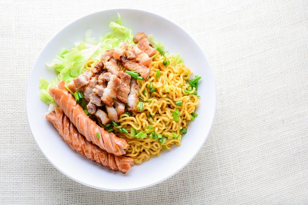 Udon noodles with grilled pork, sausage and cabbage - japanese cuisine