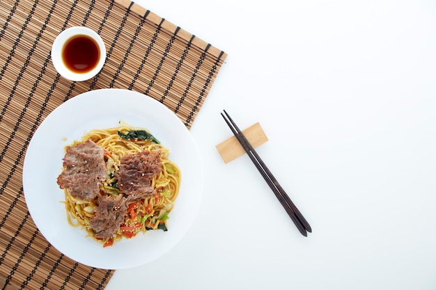 Udon noodles with vegetables, beef meet.