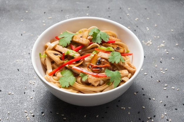 Udon wheat noodles with chicken and vegetables