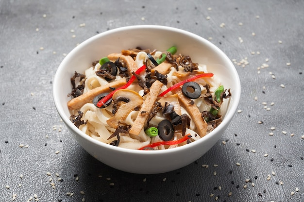 Udon with chicken, vegetables and mushrooms. japanese cuisine
