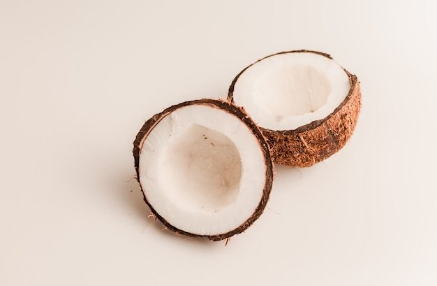 Ugly organic coconut on a white , isolate. a broken nut in a shell the white insides of a coconut