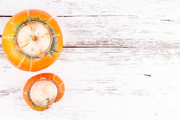 Ugly pumpkins on wooden table with copy space, concept of zero waste production
