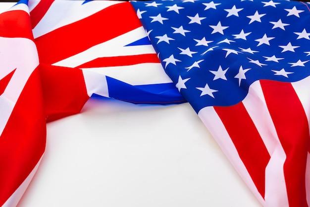 Uk flag and usa flag on white