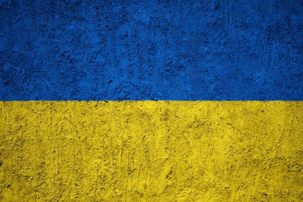 Ukraine flag painted on grunge wall