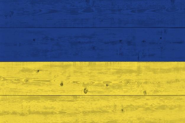 Ukraine flag painted on old wood plank