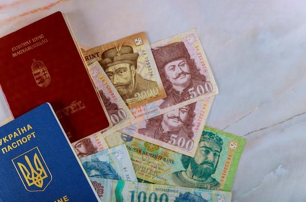 Ukrainian biometric passport and hungarian passport money on money banknotes forints