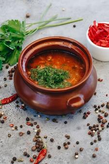 Ukrainian borscht in a clay pot