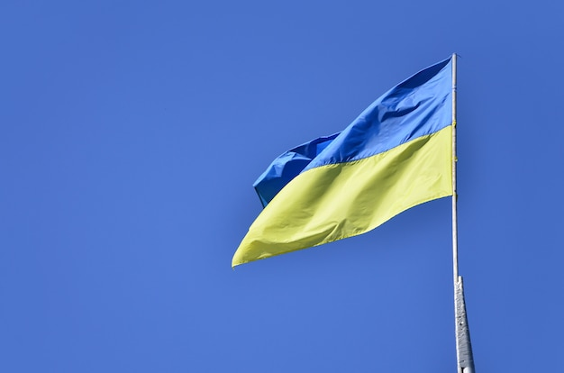 Ukrainian flag against the blue cloudless sky. the official flag