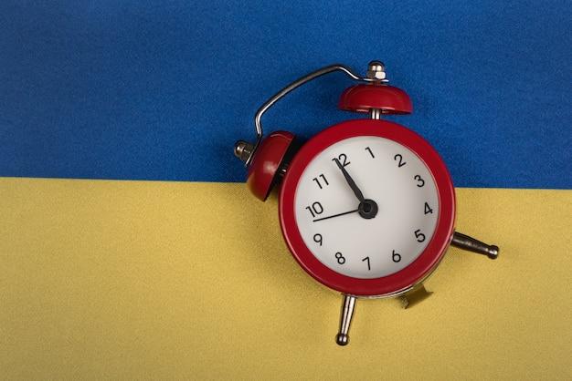 Ukrainian flag and vintage alarm clock