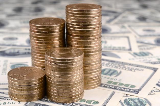 Ukrainian money lies on many us hundred dollar bills