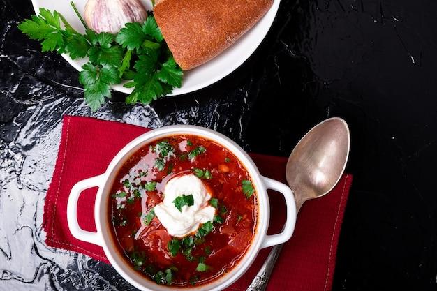 Ukrainian vegetarian red soup in white bowl