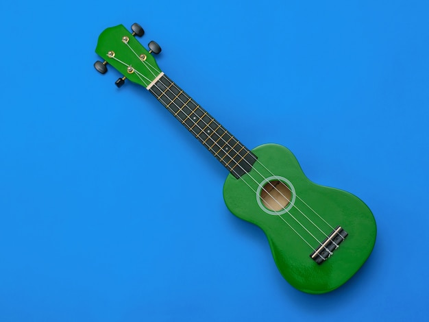Ukulele on blue background. the view from the top.