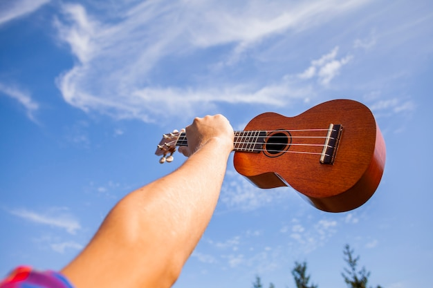 Ukulele guitar being hold in the air