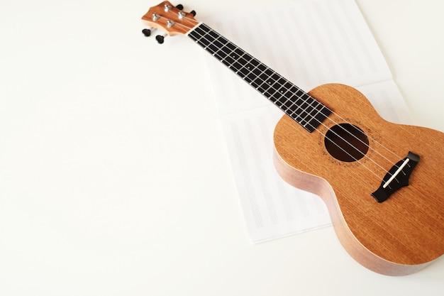 Ukulele guitar, music book.