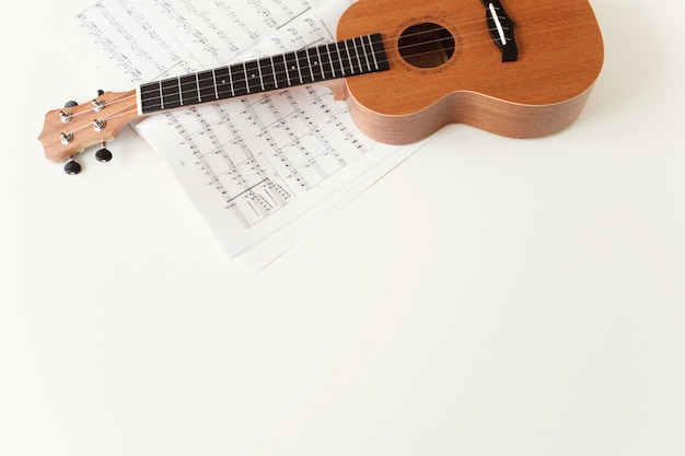 Ukulele guitar, sheet music.