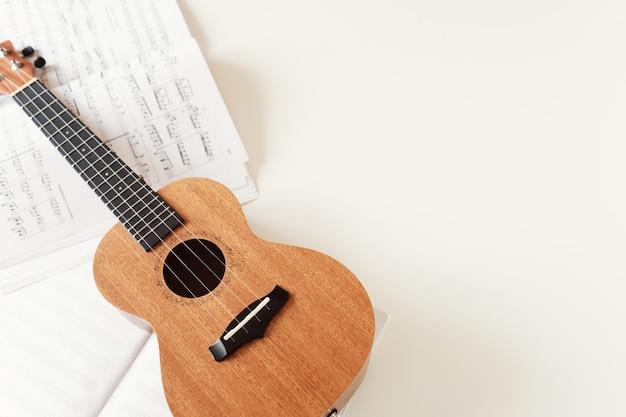Ukulele guitar, sheet music.