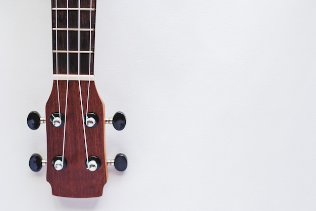 Ukulele on white background for musical instrument and relaxation concept