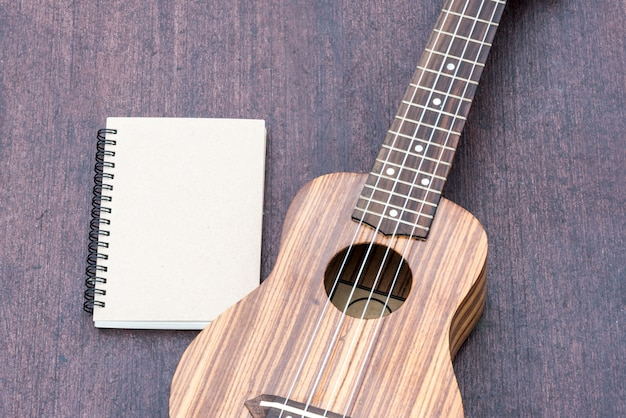 Ukulele with the notebook