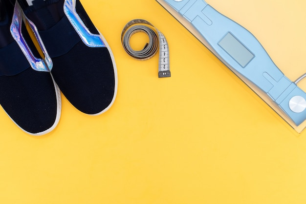 Ultra blue sneakers on yellow. concept of healthy lifestyle