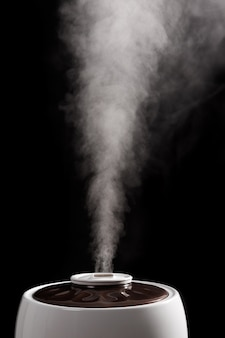An ultrasonic humidifier on a black background