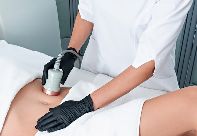 Ultrasound cavitation body contouring treatment. woman getting anti-cellulite and anti-fat therapy on her leg in beauty salon