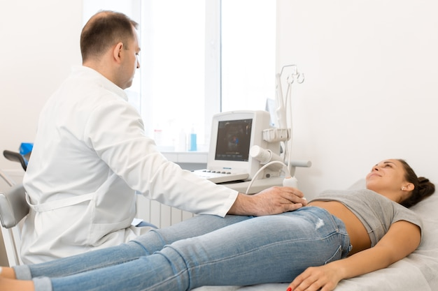 Ultrasound diagnosis of the pelvic organs woman couch of ultrasound diagnostic