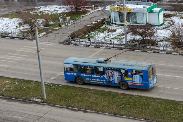 Ulyanovsk, russia - december 03, 2019: old trolleybus ziu-10 at the public transport stop in the winter sunny day. environmentally friendly transport.