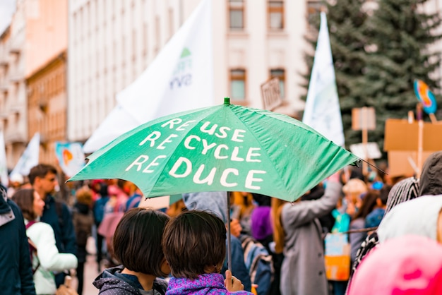 Umbrella of activist with environmental message